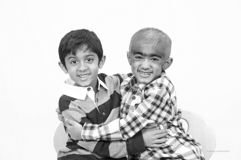 Hadi (right) with his brother, Zakaria (left)